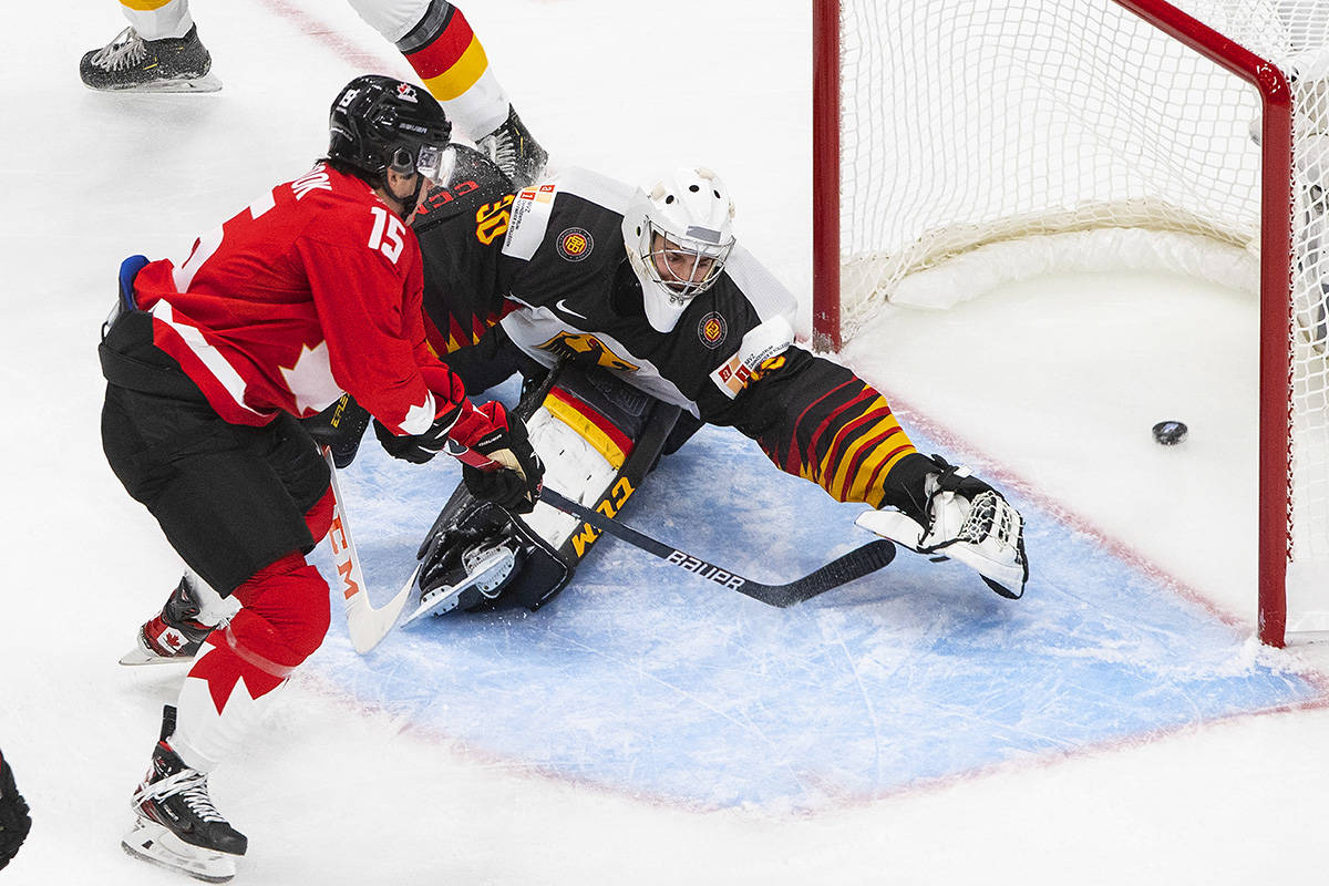 Canada's Alex Newhook (15) scores a goal on Germany's goalie Jonas Gahr (30) during second period IIHF World Junior Hockey Championship action in Edmonton on Saturday, Dec. 26, 2020. THE CANADIAN PRESS/Jason Franson