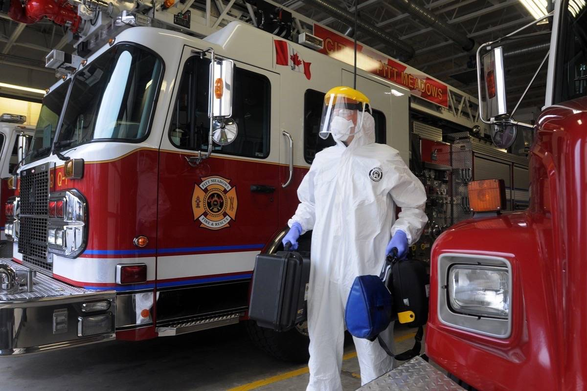 """""""This Pitt Meadows firefighter was already putting his life on the line before COVID-19 reared its ugly head. Here he is decked out in full PPE in April."""" (Colleen Flanagan/Maple Ridge News)"""