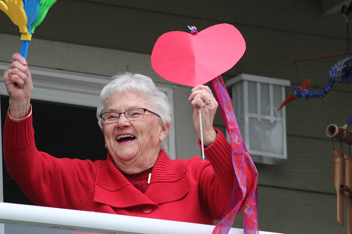 Dawn Dickson, a resident at Berwick on the Lake Retirement Community, grooves on her balcony during a dance-off. Dickson and her neighbours were answering a challenge from Berwick Qualicum Beach. (Karl Yu/Nanaimo News Bulletin)