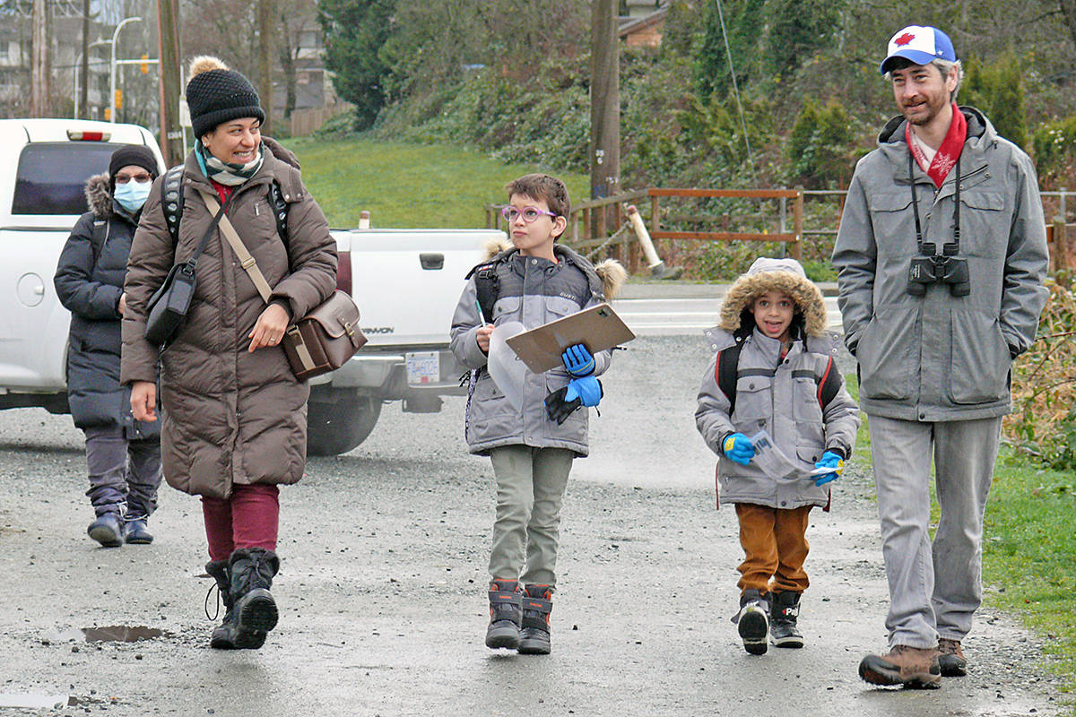 At Brydon lagoon, families were turning out from the annual bird count. Mom Nehal Saleh, brothers Zach and Aden and dad James Boone, up front, were accompanied by grandmother Lela Rachi (following on the left) (Dan Ferguson/Langley Advance Times)