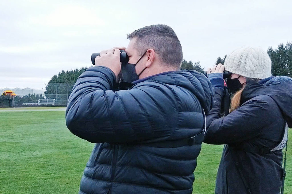 """Mike Klotz and Carli Wyllie looked for birds in Murrayville on Sunday, Dec. 27, 2020. This year's annual count was carried out under COVID-19 restrictions that limited the number of people on teams to those in each other's """"bubble,"""" like Klotz and Wyllie, or immediate family. (Dan Ferguson/Langley Advance Times)"""