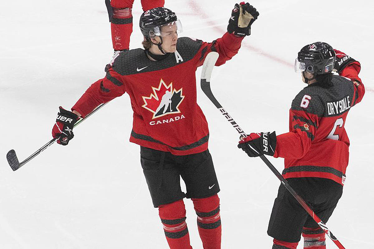 Canada's Bowen Byram (4) and Jamie Drysdale (6) celebrate a goal against the Russia during third period IIHF World Junior Hockey Championship pre-competition action in Edmonton on Wednesday, December 23, 2020. (THE CANADIAN PRESS/Jason Franson)