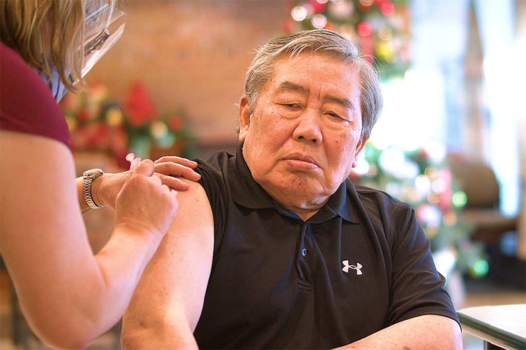 Andy Yoon of Abbotsford receives his first dose of the COVID-19 vaccine on Dec. 24. (Photo courtesy of Fraser Health)