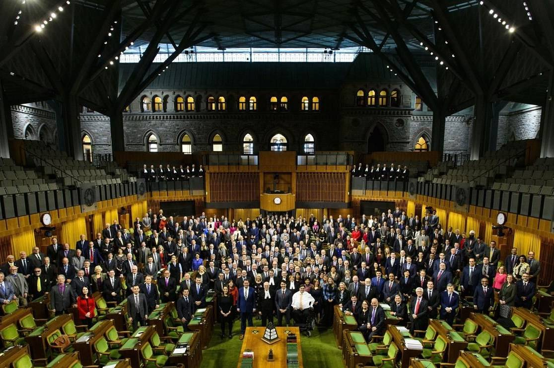 Members of Parliament gather for a group photo in the temporary House of Commons in the West Block of Parliament Hill in Ottawa on Wednesday, Jan. 30, 2019. THE CANADIAN PRESS/Sean Kilpatrick