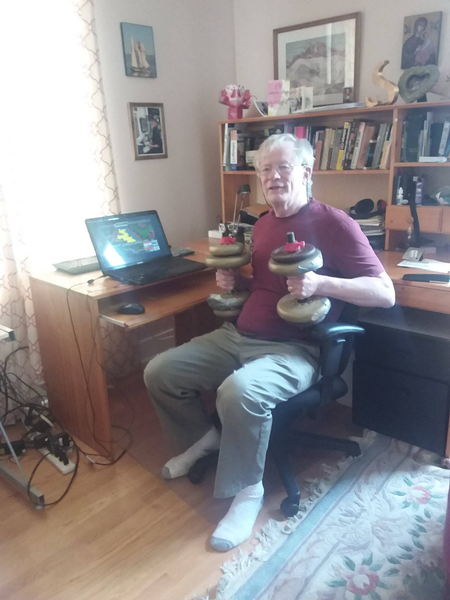 Steve Weatherbe has started exercising and playing a turn-based computer game from the 1990s. Whenever it's the computer's turn, he lifts weights. (Courtesy of Steve Weatherbe)