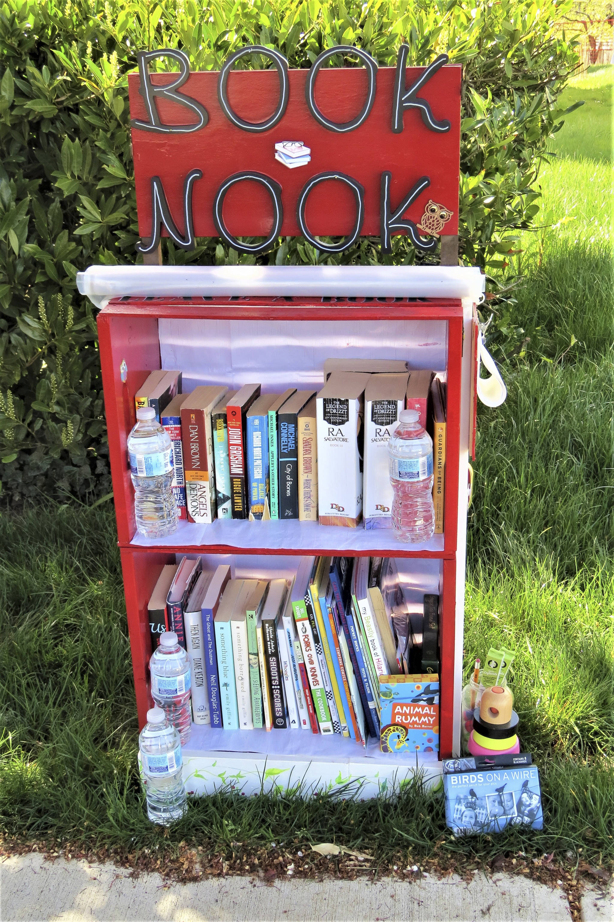 "Stephanie McColl created a ""book nook"" in Sidney to give people in her neighbourhood – especially seniors – a reason to get outside. She says it's brought the neighbourhood together. (Courtesy of Stephanie McColl)"
