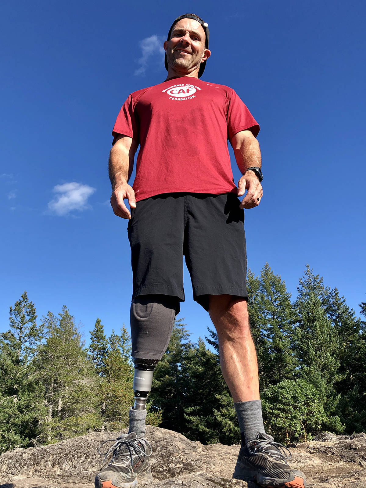 Trevor Coey atop Mount Work in September. Coey longs to run the roads and trails like he did before he lost his leg in an accident three years ago. (Photo courtesy of Trevor Coey)