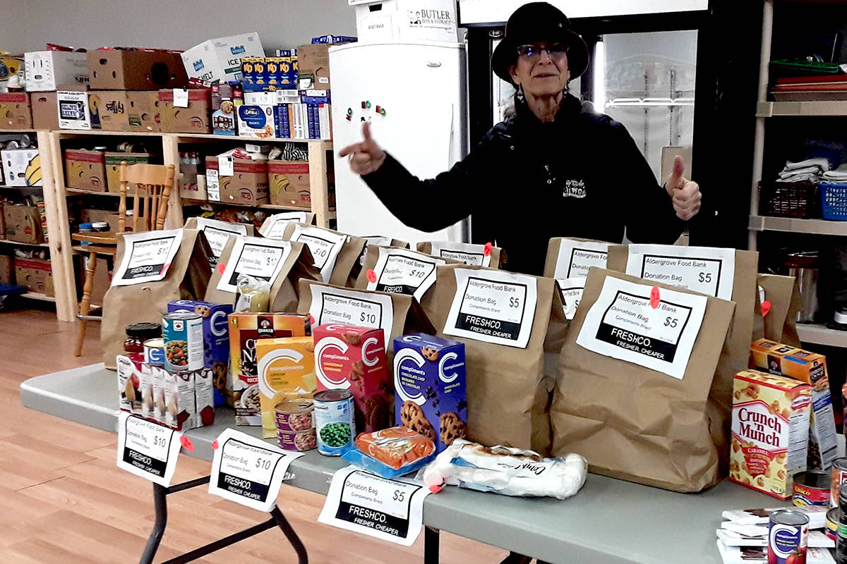 Tannis Percival, Assistant Manager of the Food Bank, showing typical items found in the Freshco bags. (Mary van Zuuk/Special to the Aldergrove Star)