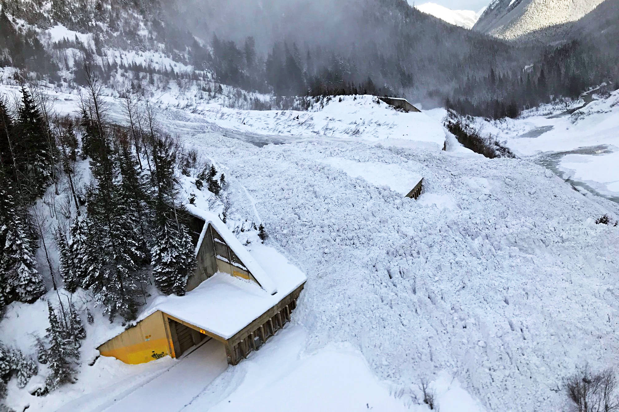 Avalanche control conducted on Thursday, Dec. 23, brought snow and debris safely down over top of the Lanark show shed on Highway 1 approximately 46 kilometres east of Revelstoke. (BC Transportation and Infrastructure photo)