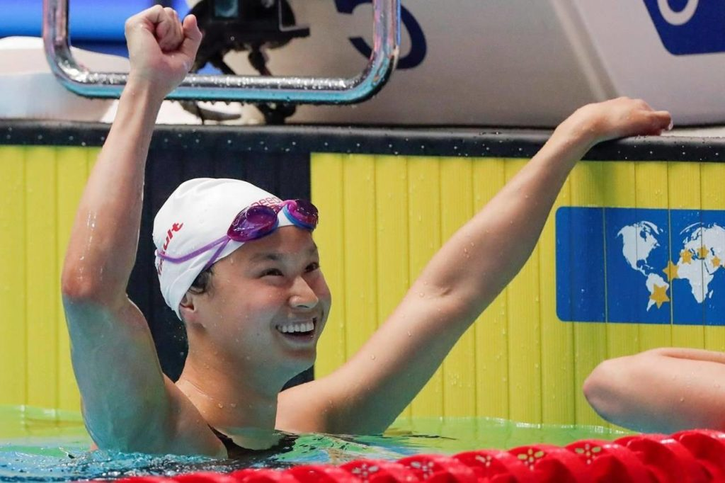 Canada's Margaret Mac Neil reacts after winning the women's 100m butterfly final at the World Swimming Championships in Gwangju, South Korea, Monday, July 22, 2019. When COVID-19 shut down the NCAA swimming season last March, Margaret Mac Neil packed up her car and drove home to London, Ont., from the University of Michigan. In the whirlwind days that followed, Canada announced it wouldn't compete in the 2020 Tokyo Olympic and Paralympic Games if they were held as scheduled. The Games were eventually postponed to 2021. THE CANADIAN PRESS/AP, Lee Jin-man