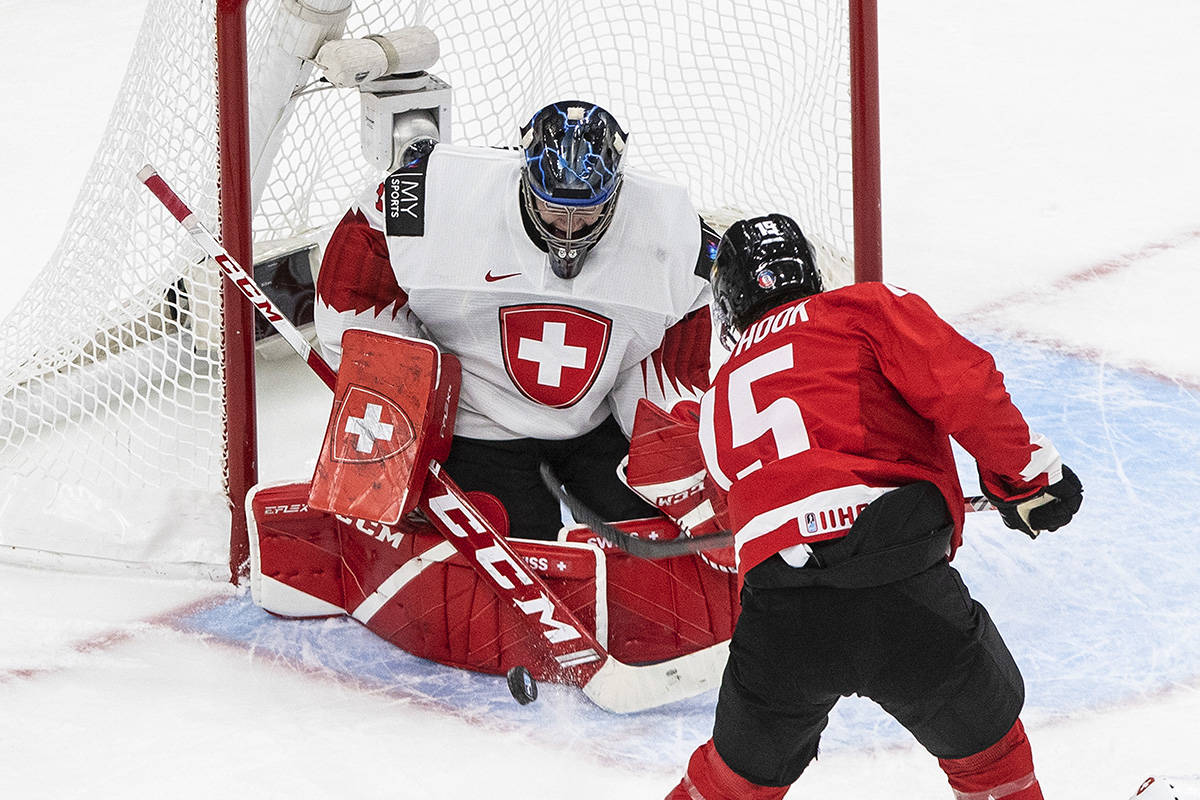 Canada's Alex Newhook (15) is stopped by Switzerland goalie Noah Patenaude (1) during first period IIHF World Junior Hockey Championship action in Edmonton on Tuesday, December 29, 2020. THE CANADIAN PRESS/Jason Franson