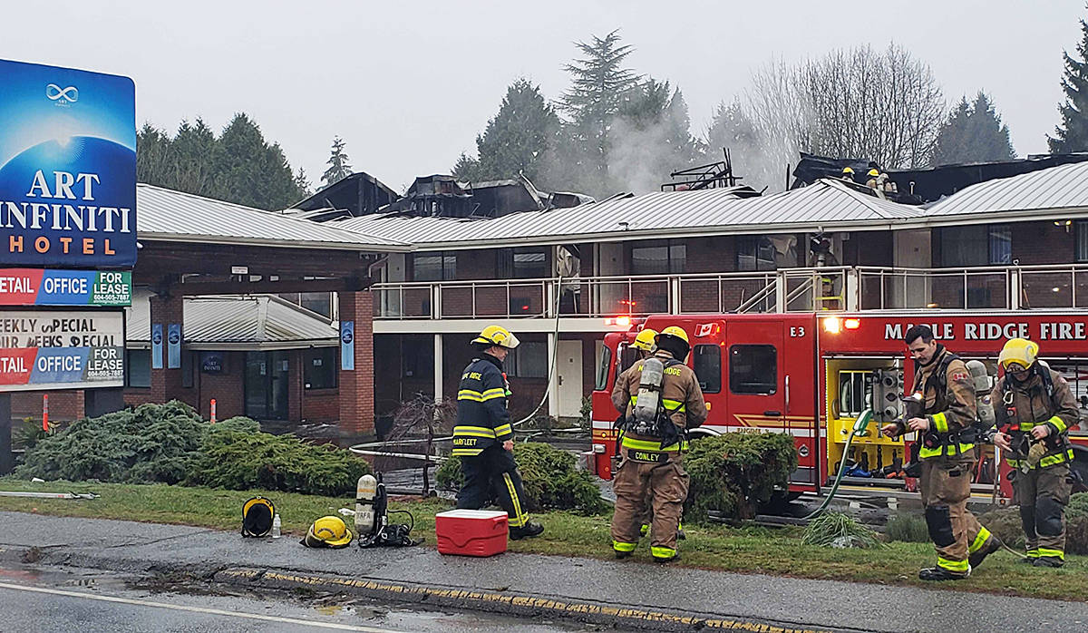By 9 a.m. on New Year's Eve firefighters were in the mop-up stages, after fighting a stubborn hotel fire in the early morning. (Neil Corbett/The News)