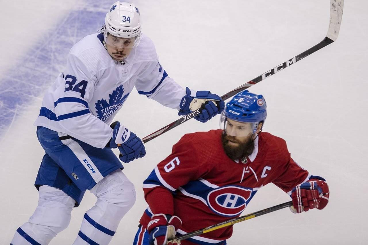 Toronto Maple Leafs centre Auston Matthews (34) trails Montreal Canadiens defenceman Shea Weber (6) during first period NHL exhibition hockey action ahead of the Stanley Cup playoffs in Toronto on Tuesday, July 28, 2020. THE CANADIAN PRESS/Frank Gunn