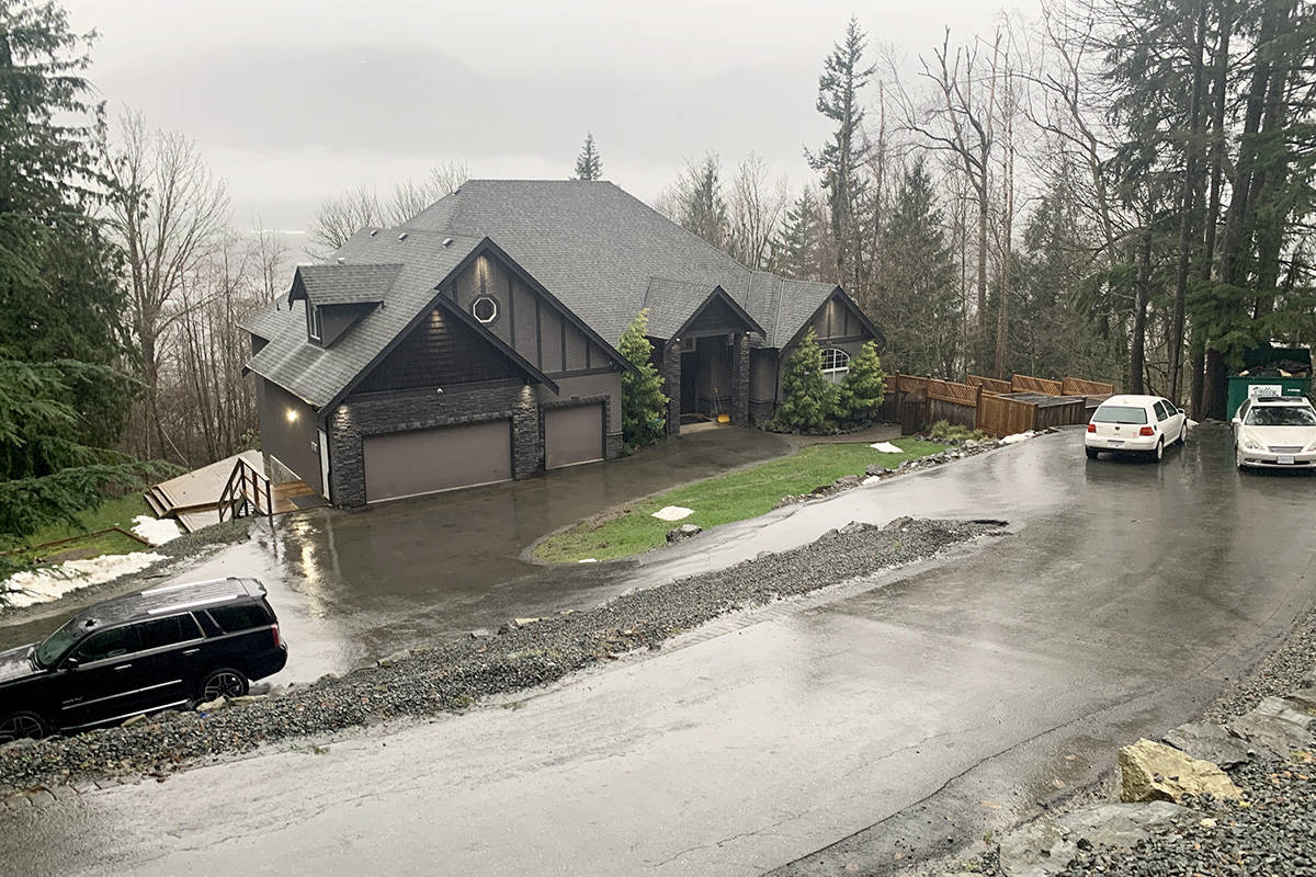 B.C.'s Director of Civil Forfeiture is seeking to claim part of the value of this house on Chelmsford Drive in Chilliwack valued at $1.1 million, as seen here on Dec. 30, 2020, which was allegedly purchased with the proceeds of illegal drug trafficking. (Paul Henderson/ Chilliwack Progress)