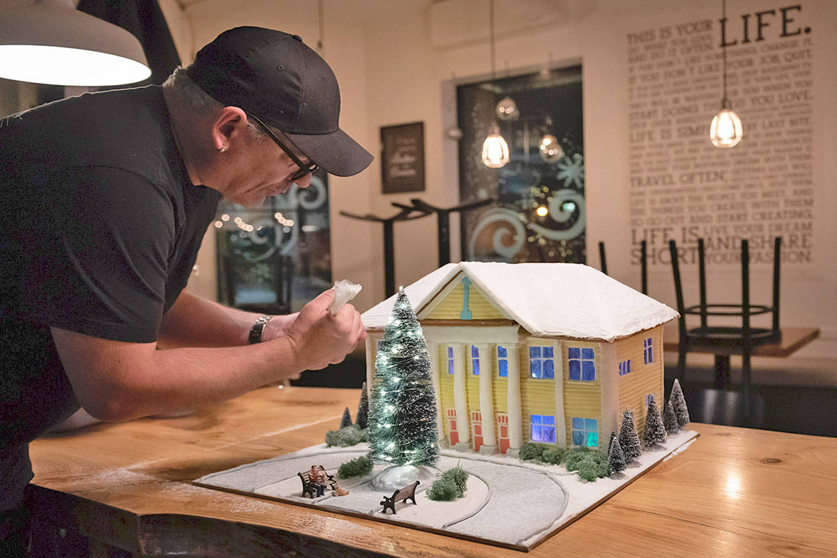 Chef Stephan Schigas didn't have to travel far for inspiration for a gingerbread building. The owner of the Blacksmith Bakery created a gingerbread Fort Langley Community Hall. (Crocodile Creative/Special to the Langley Advance Times)