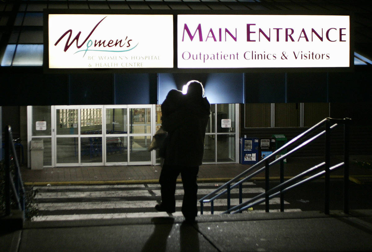A woman enters BC Women's Hospital in Vancouver, B.C., Sunday, January 7, 2007. (Richard Lam/CP PHOTO)