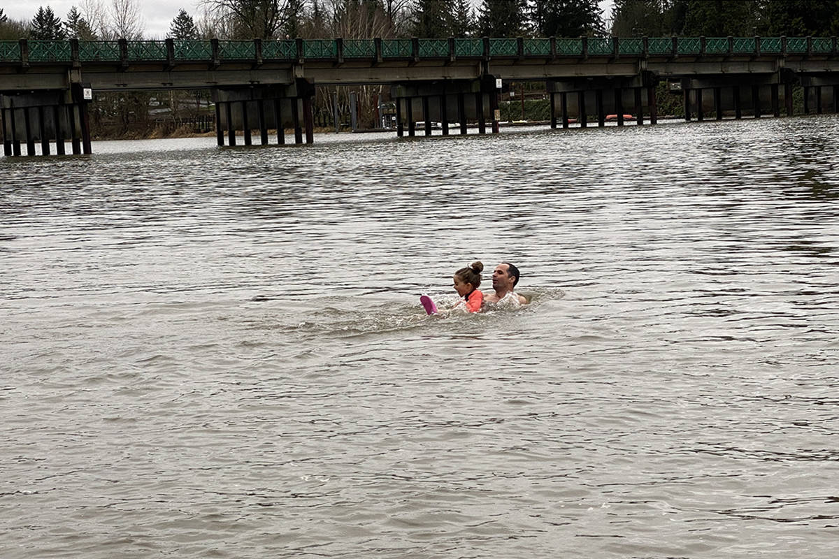 About 30 people braved the chilly water on New Year's Day 2020 in Fort Langley for the annual unofficial polar bear plunge. (Joti Grewal/Langley Advance Times)