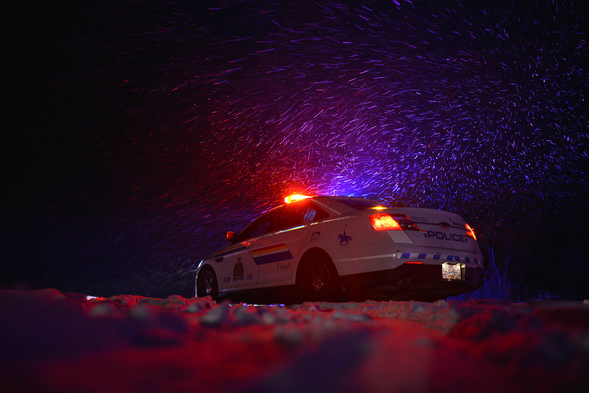 RCMP pictured at a motor vehicle incident during snowy conditions. (FILE - Phil McLachlan/Black Press Media)