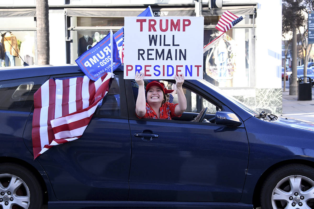Trump supporters parade along the Rose Parade route on Colorado Blvd in Pasadena, Calif., on Friday, Jan. 1, 2021. (Keith Birmingham/The Orange County Register via AP)