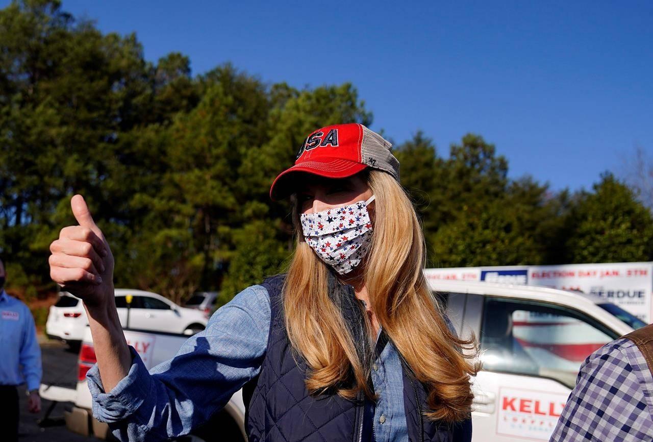 Sen. Kelly Loeffler, R-Ga., greets a crowd after she spoke at a campaign rally on Saturday, Jan. 2, 2021, in Cumming, Ga. (AP Photo/Brynn Anderson)