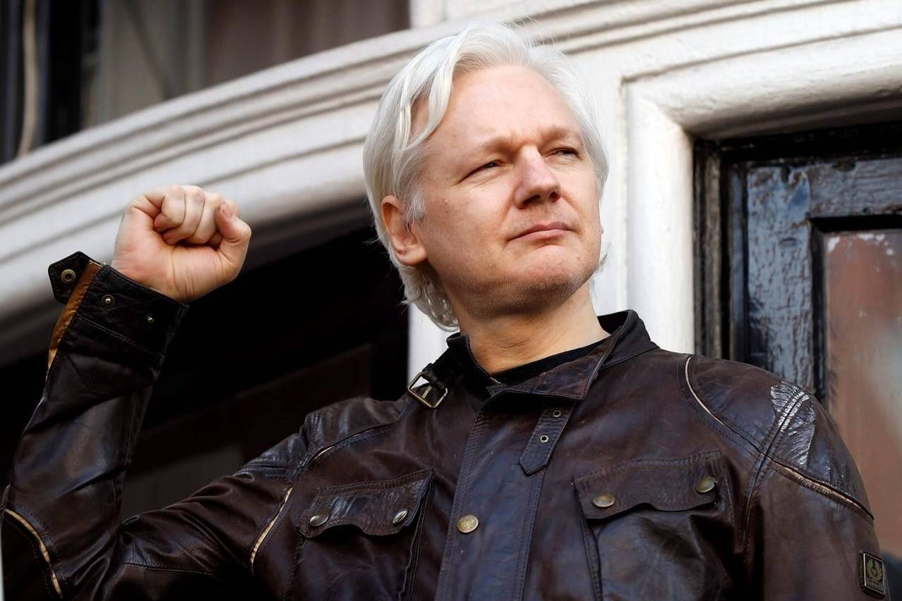 """FILE - In this May 19, 2017 file photo, WikiLeaks founder Julian Assange greets supporters outside the Ecuadorian embassy in London, where he has been in self imposed exile since 2012. Judge Vanessa Baraitser has ruled that Julian Assange cannot be extradited to the US. because of concerns about his mental health, it was reported on Monday, Jan. 4, 2021. Assange had been charged under the US's 1917 Espionage Act for """"unlawfully obtaining and disclosing classified documents related to the national defence"""". (AP Photo/Frank Augstein, File)"""