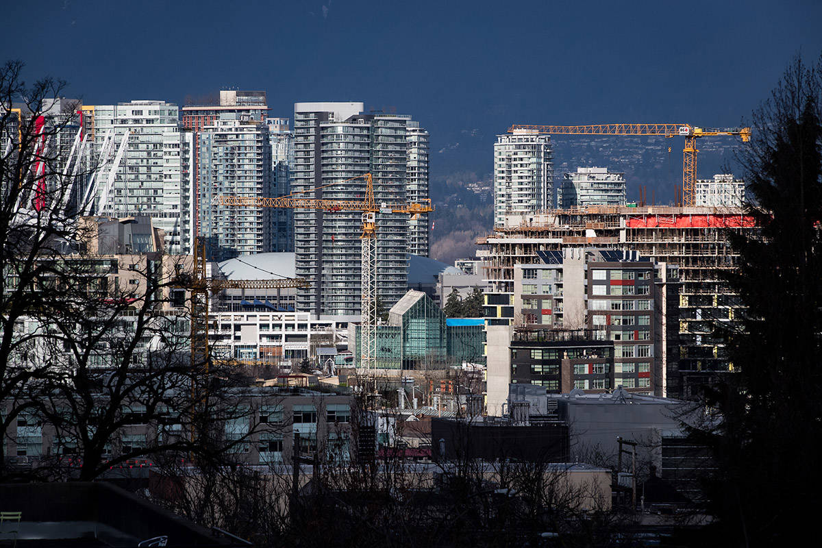 FILE – Construction cranes tower above condos under construction near southeast False Creek in Vancouver on February 9, 2020. THE CANADIAN PRESS/Darryl Dyck