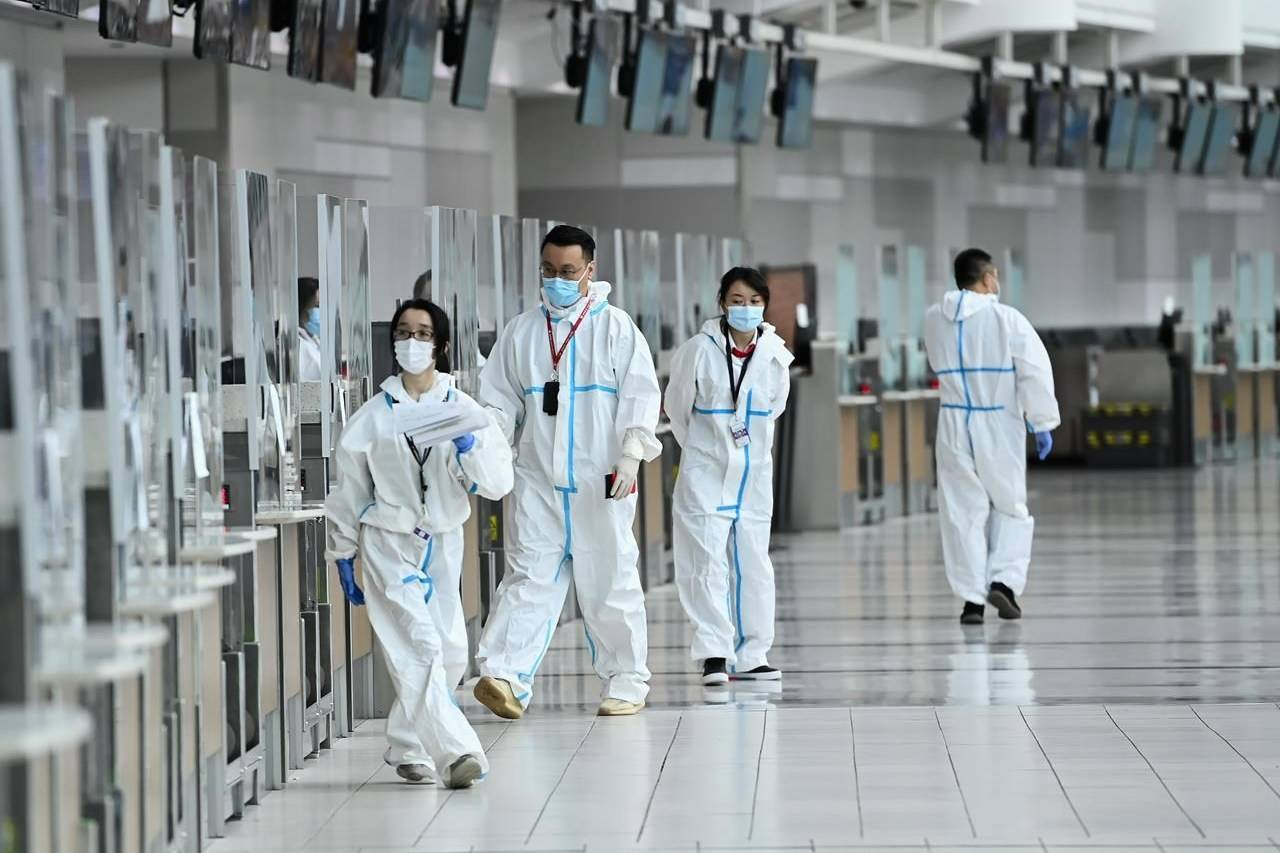 Workers are seen at a check-in counter at Pearson International Airport during the COVID-19 pandemic in Toronto on Wednesday, Oct. 14, 2020. Airlines say a slew of questions remain around the federal government's decision that requires returning passengers to first show negative results on COVID-19 tests taken abroad. THE CANADIAN PRESS/Nathan Denette