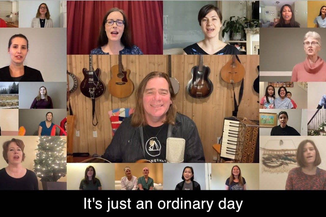 "Great Big Sea's Alan Doyle (center) sings ""Ordinary Day"" with a virtual choir of 200 physicians from all over Canada. The video draws attention to A Dollar A Day Foundation, which supports those suffering with mental health and addiction issues. (Screenshot/YouTube)"