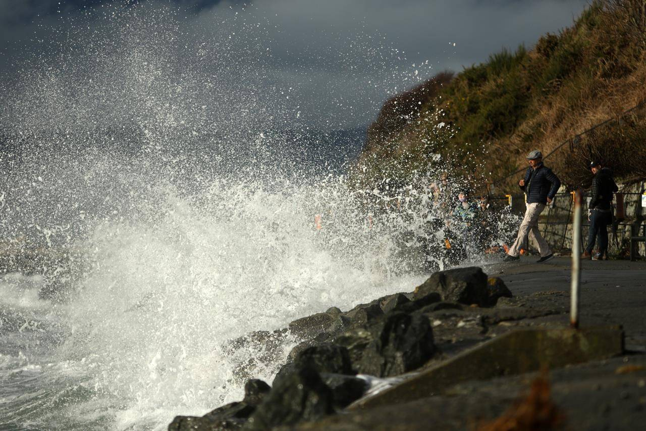 High tide rolls in along Dallas Rd. on New Years Day in Victoria, B.C., on Friday, January 1, 2021. THE CANADIAN PRESS/Chad Hipolito