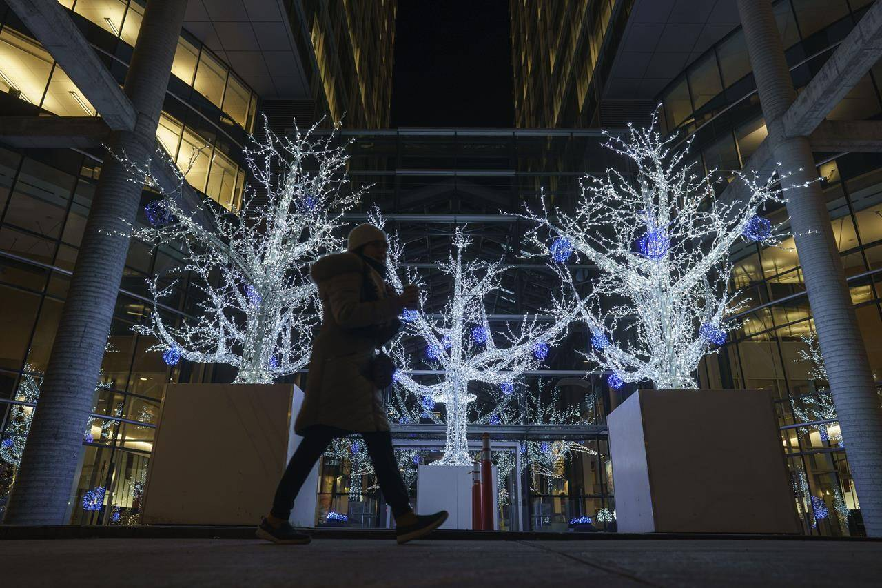Christmas decorations are seen in front of an office building in Montreal, Thursday, Nov. 19, 2020. A new survey suggests nearly half of Canadians visited with family or friends over the winter holiday period. THE CANADIAN PRESS/Paul Chiasson