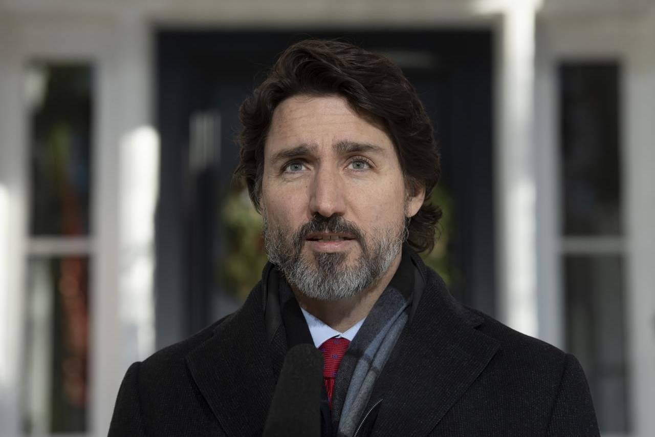 Prime Minister Justin Trudeau delivers his opening remarks during a news conference outside Rideau Cottage in Ottawa, Friday, December 18, 2020. THE CANADIAN PRESS/Adrian Wyld