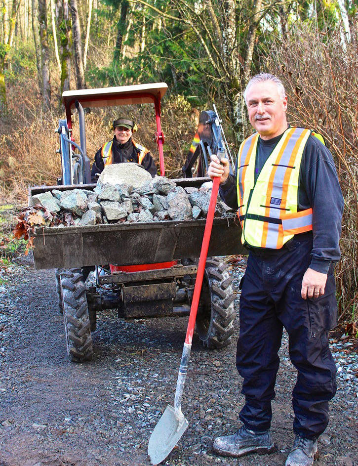 Dave Grant (on tractor) and BCHBC Aldergrove vice-chairman Peter Thiessen were just two of the 25 volunteers who worked on the multi-use South Langley Trail. Thiessen recently passed away at his home in Summerland. (Black Press Media files)