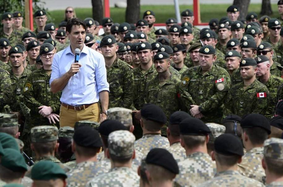 Prime Minister Justin Trudeau addresses the troops at Adazi Military Base in Kadaga, Latvia, on Tuesday, July 10, 2018. THE CANADIAN PRESS/Sean Kilpatrick