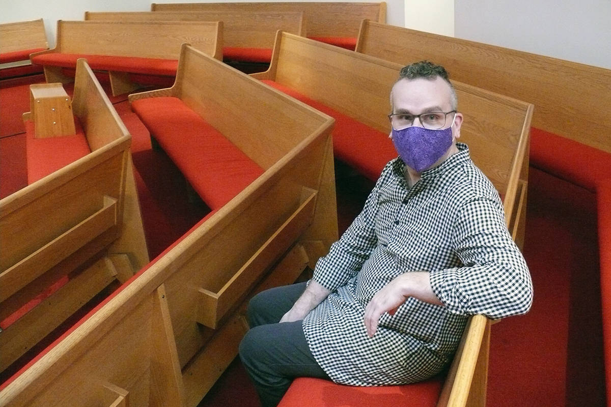 Rev. Andrew Halladay, the vicar at St. Andrew's Anglican Church in Langley, sits in an empty pew on Tuesday, Jan. 5. His church had to move online because of COVID-19 limits on public gatherings. Halladay is one of 38 church leaders in B.C. to sign a joint letter of support for provincial health officer Dr. Bonnie Henry. (Dan Ferguson/Langley Advance Times)