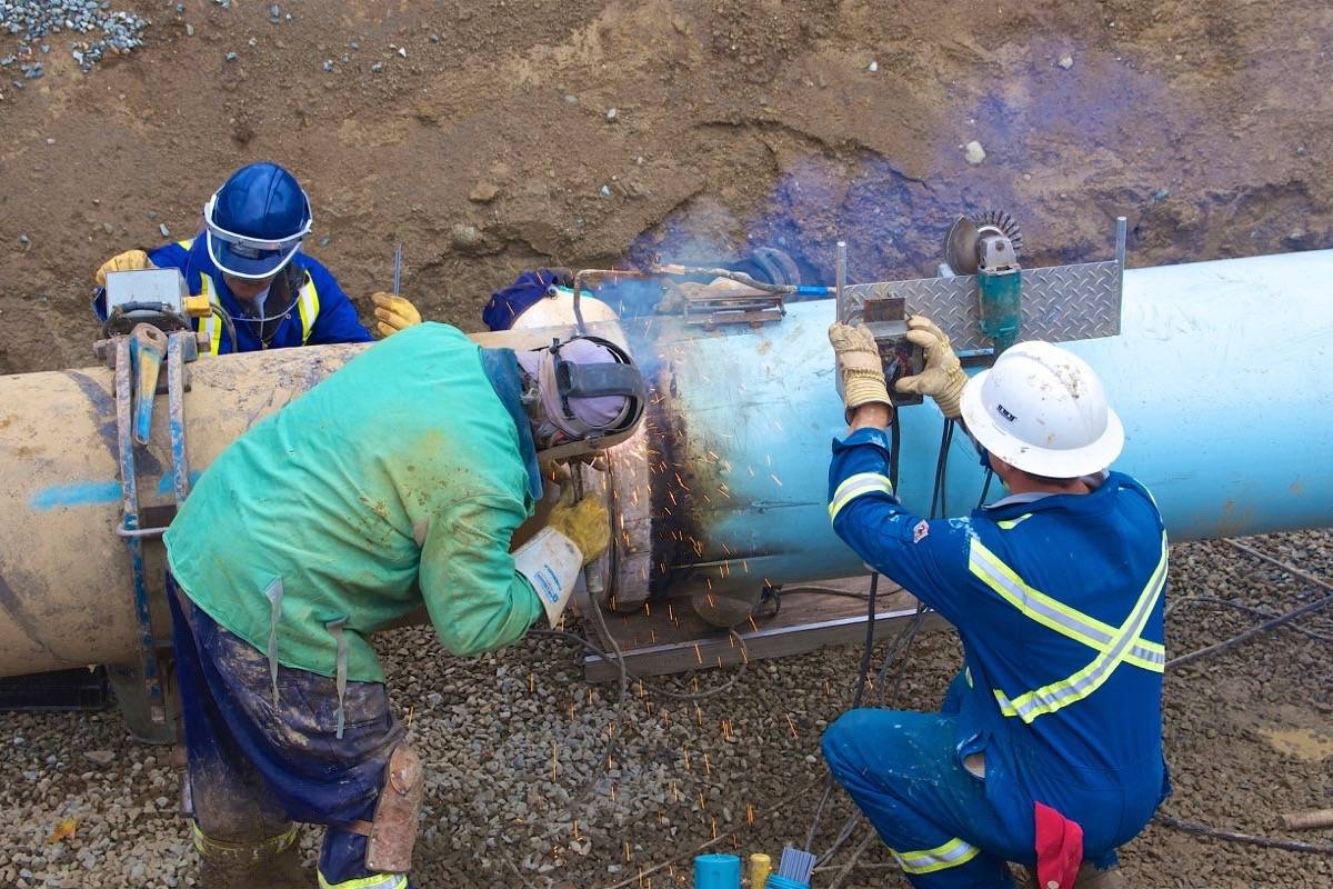 Maintenance on the Trans Mountain pipeline, which has run from Alberta to B.C. and Washington since 1954. B.C.'s apprenticeship training system involves traditional trades such as pipefitter, electrician and carpenter, as well as cooking, aircraft maintenance and other skills. (Trans Mountain photo)