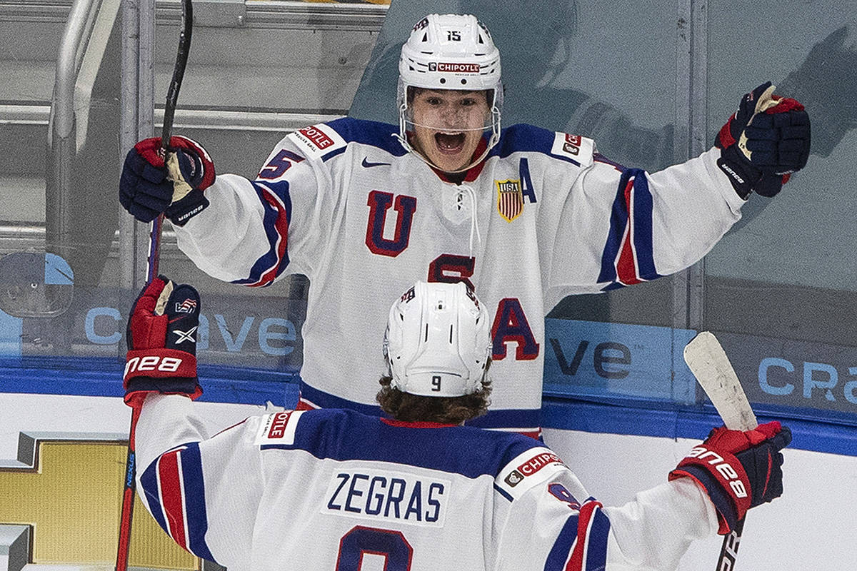 United States' Alex Turcotte (15) and Trevor Zegras (9) celebrate a goal against Canada during first period IIHF World Junior Hockey Championship gold medal game action in Edmonton on Tuesday, Jan. 5, 2021. THE CANADIAN PRESS/Jason Franson