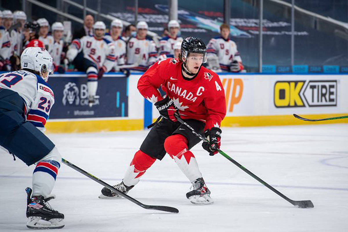 Giants defenceman Bowen Byram looks for an opening during a hard-fought gold medal matchup with Team USA in Edmonton at the world juniors on Tuesday, Jan. 5. USA won 2-0. (Andrea Leigh Cardin/HHOF-IIHF Images)