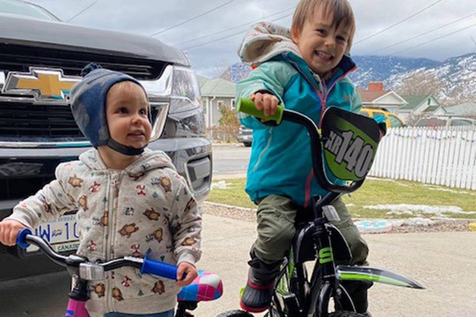 Kids, ages two and four, are all smiles after receiving new bikes from total strangers. Their bikes were stolen on New Year's Day when out for a walk near Penticton Ave. By the next day, strangers donated to replace the bikes. (Dawn Jones Facebook)