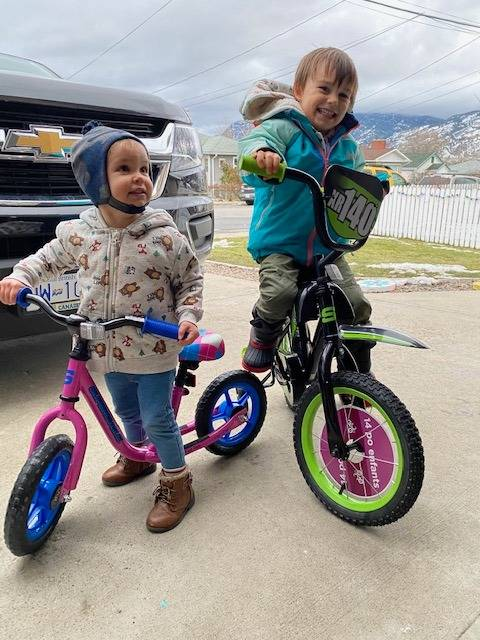 Kids, ages 2, and 4, are all smiles after receiving new bikes from total strangers. Their bikes were stolen on New Year's Day when out for a walk near Penticton Ave. By the next day, strangers donated to replace the bikes. (Dawn Jones Facebook)