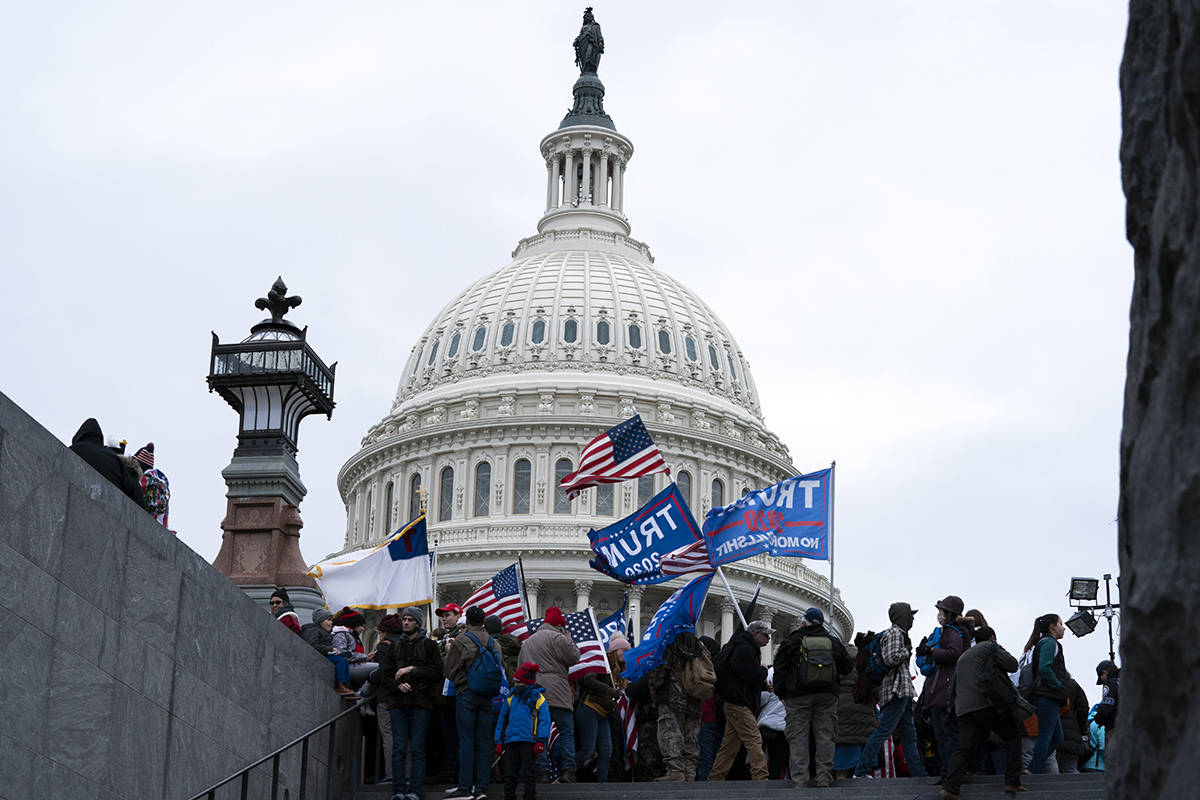 Supporters of President Donald Trump rally outside of the U.S. Capitol on Wednesday, Jan. 6, 2021, in Washington. (AP Photo/Jose Luis Magana)