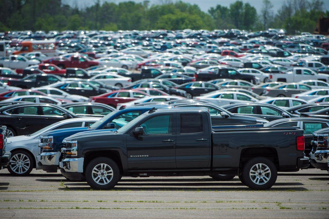 Vehicles are seen in a parking lot at the General Motors Oshawa Assembly Plant in Oshawa, Ont., on June 20, 2018. THE CANADIAN PRESS/ Tijana Martin
