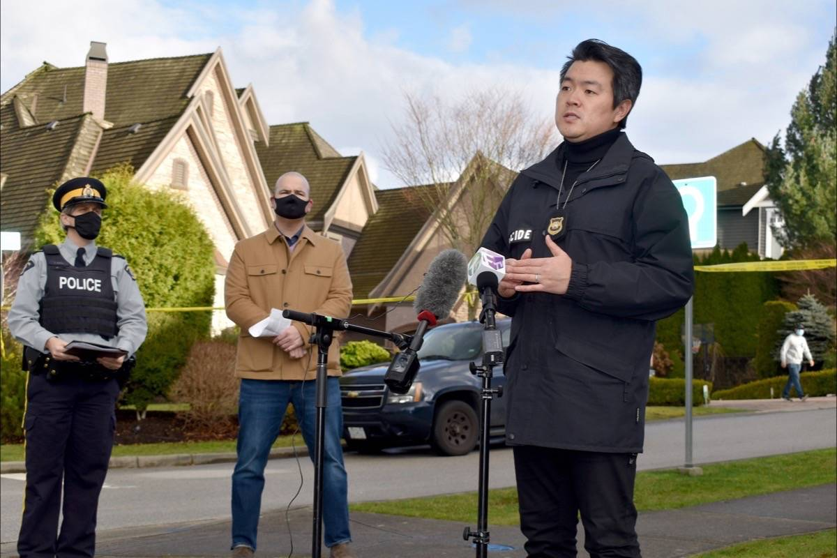 IHIT Sgt. Frank Jang – accompanied by Surrey RCMP Sgt. Elenore Sturko (left) and CFSEU-BC Staff Sgt. Lindsey Houghton (centre) – speaks to the Jan. 6 early morning homicide, during a press conference Wednesday afternoon. (Tracy Holmes photo)