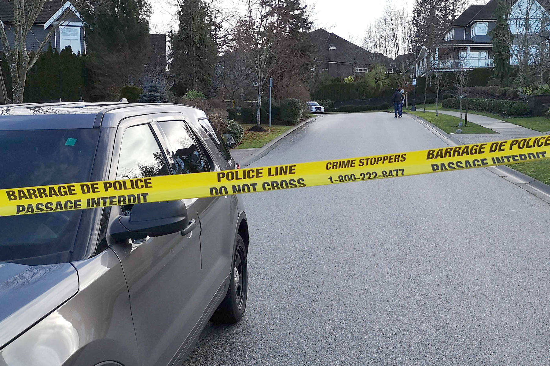 Police tape blocks the road in Morgan Heights near the scene of a homicide Wednesday morning. (Tracy Holmes photo)