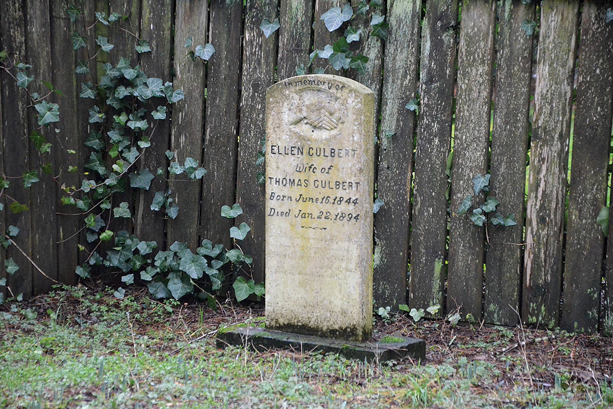 The grave of Ellen Culbert on 216th Street in Langley. The pioneer cemetery is a tiny separate property of its own. (Matthew Claxton/Langley Advance Times)