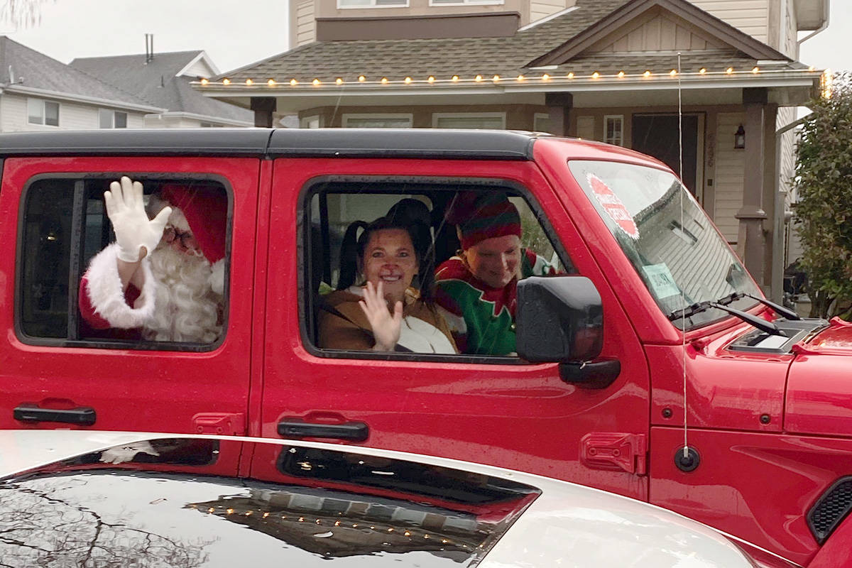Sean and Jen Gallawan, alongside Jen's sister the reindeer, made distanced visits to 20 different families on Dec. 19, 2020. (Special to Langley Advance Times)