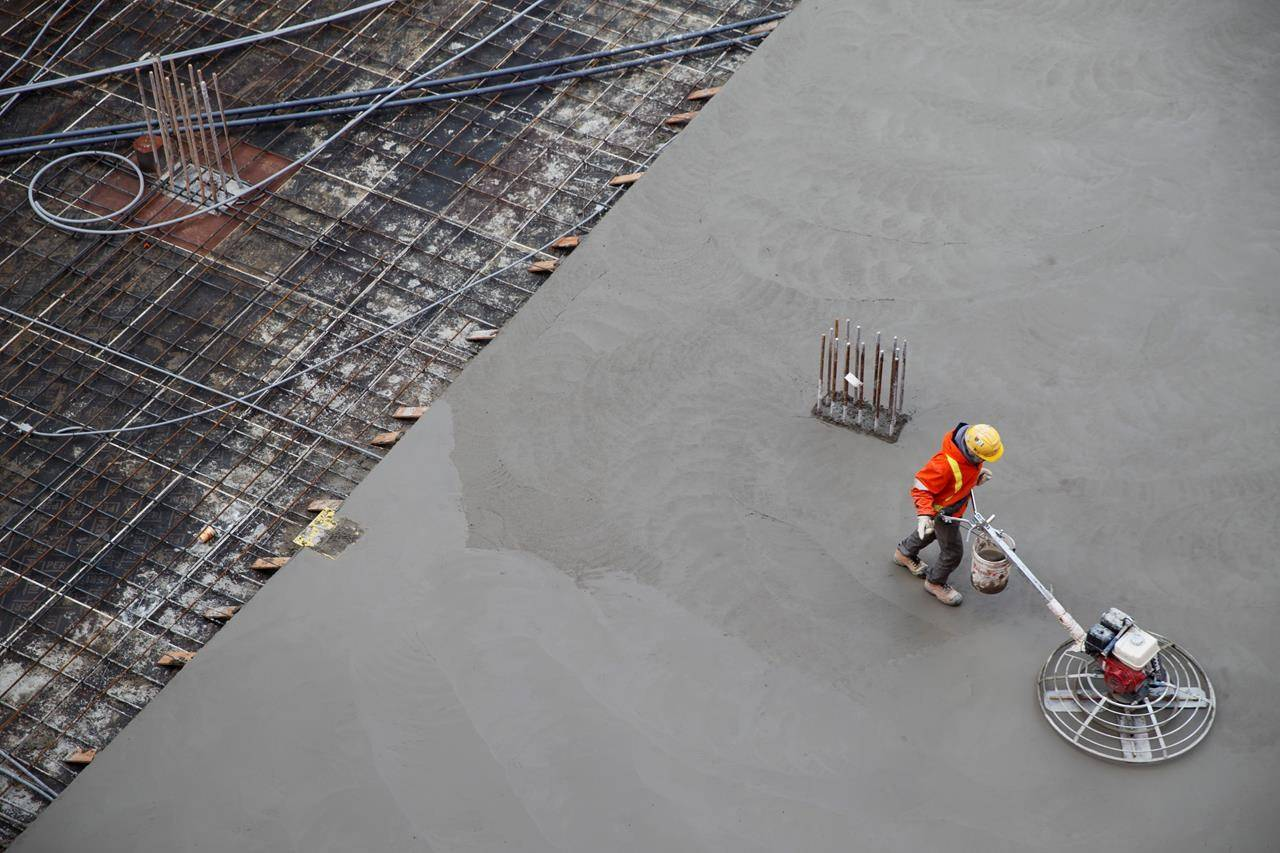 A worker smooths concrete at a construction site in Toronto, Thursday, Jan. 16, 2020. Statistics Canada is expected to release its snapshot of the Canadian job market for December this morning. THE CANADIAN PRESS/Cole Burston