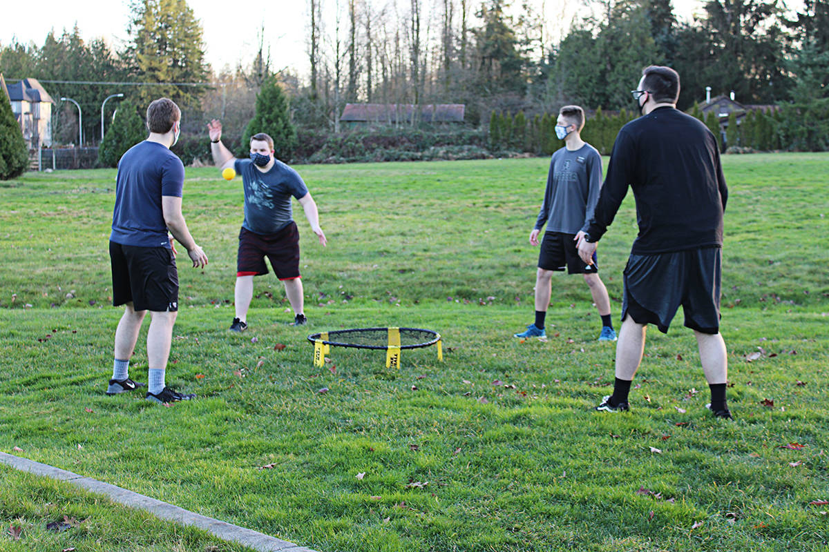 Parker Goddard, swinging at the ball) is wanting to hear from anyone interested in playing Spikeball. (Parker Goddard/Special to the Langley Advance Times)