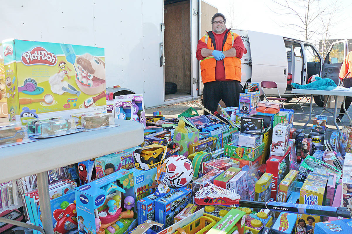 Lower Mainland Christmas Bureau executive director Chris Bayliss was surrounded by toys Sunday, Nov. 1, 2020 at the 37th annual Kruise for Kids toy drive and fundraiser held at the Langley Events Centre for the Lower Mainland Christmas Bureau. (Dan Ferguson/Langley Advance Times)
