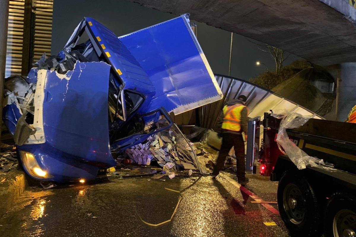 """A Surrey transport truck driver has been arrested for impaired driving and driving while prohibited after North Vancouver RCMP said the driver """"left the roadway and collided with an overpass support structure on Highway 1. (Photo: RCMP handout)"""