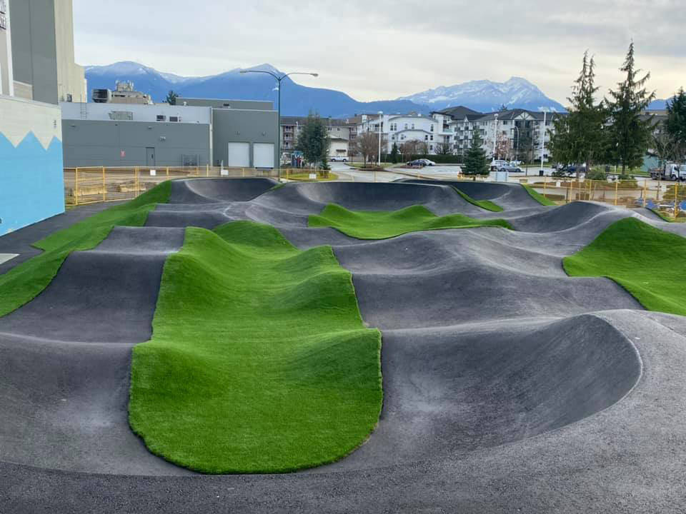 City of Chilliwack councillors stand at the freshly paved pump track which is scheduled to be open in the spring of 2021. (Facebook/ Chris Kloot)